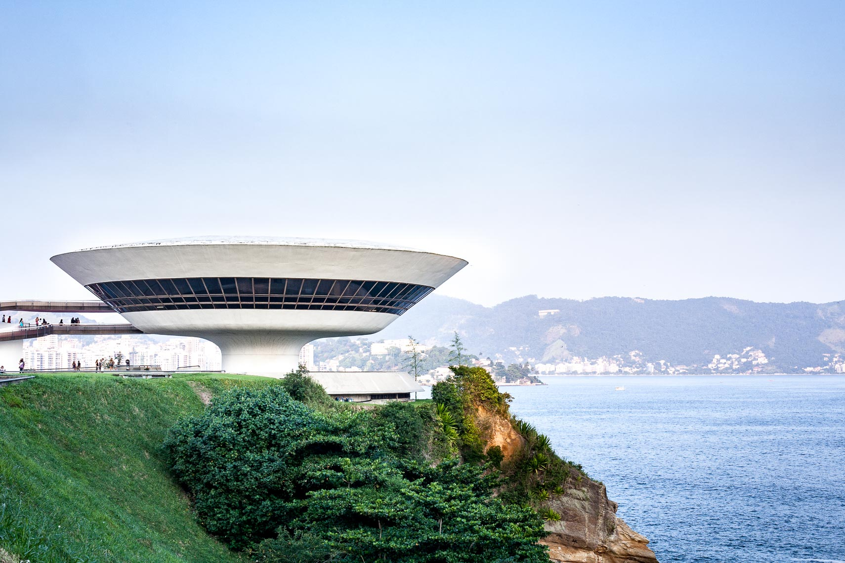UFO shaped building at the edge of a bay