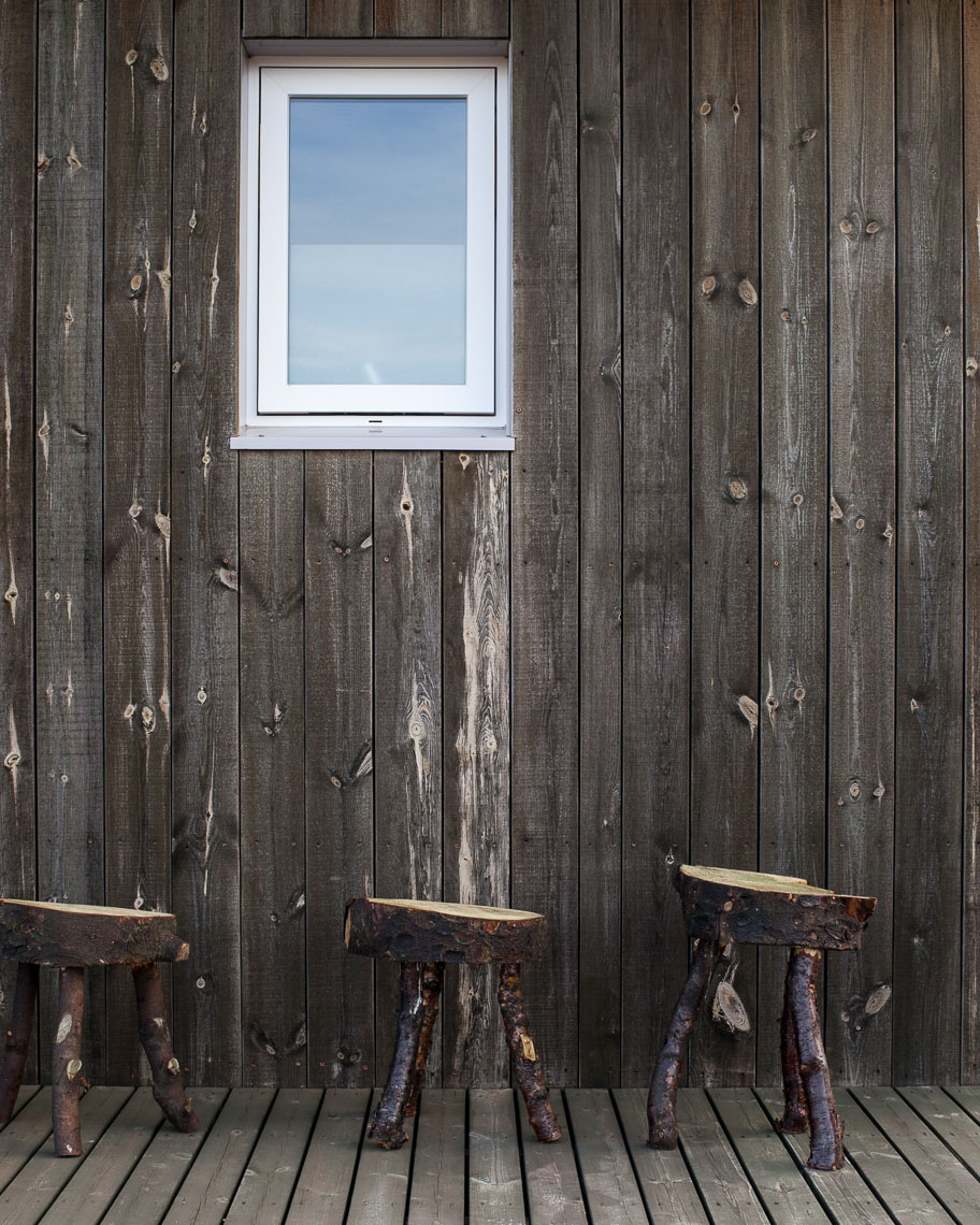Rustic wooden seating in a home in the Icelandic countryside