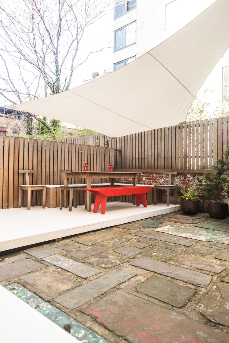 Backyard patio with angular sun shade