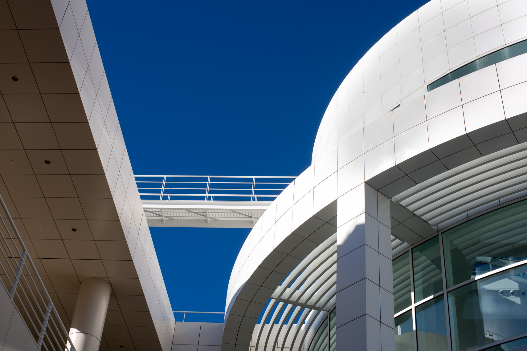 Detail of white circular building against a blue sky