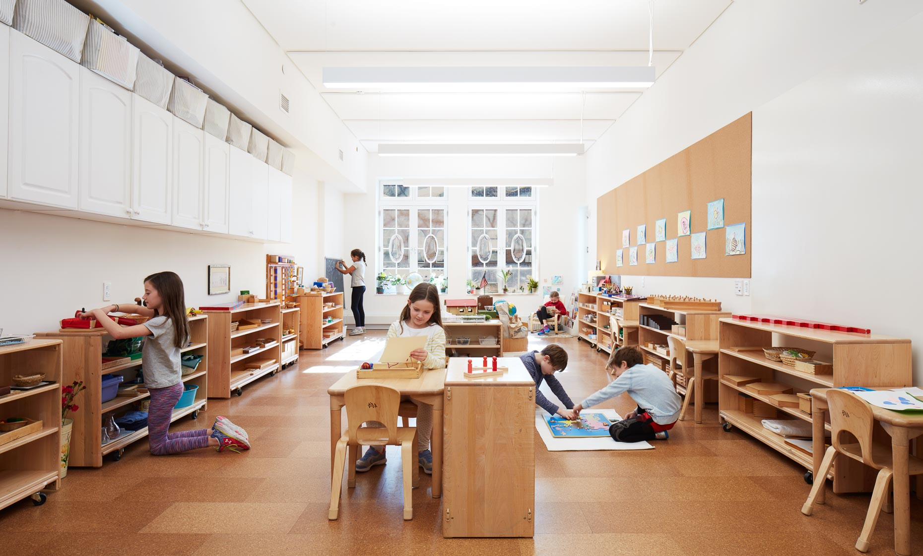 Students inside a classroom with bright interiors