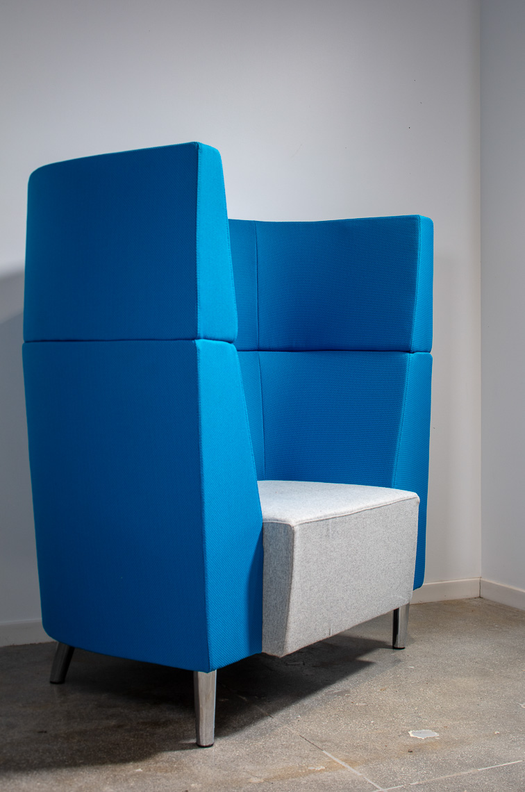 Detail of oversized sculptural blue lounge chair