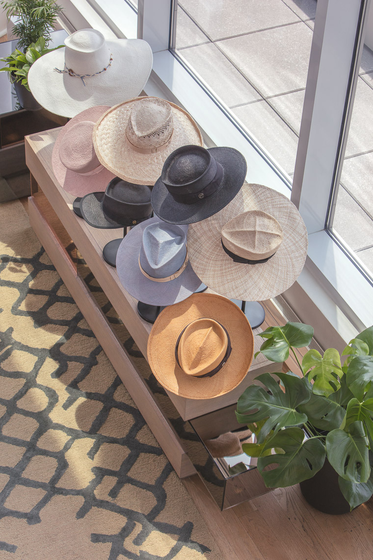 Overhead shot of row of designer hats