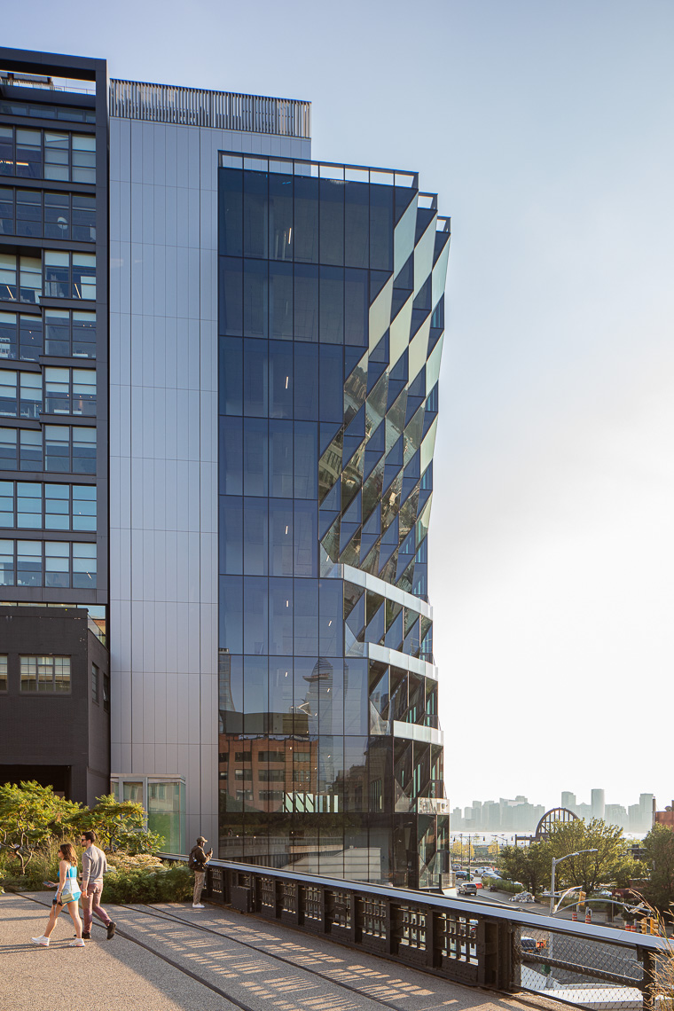 Sculpted geometric glass exterior office tower