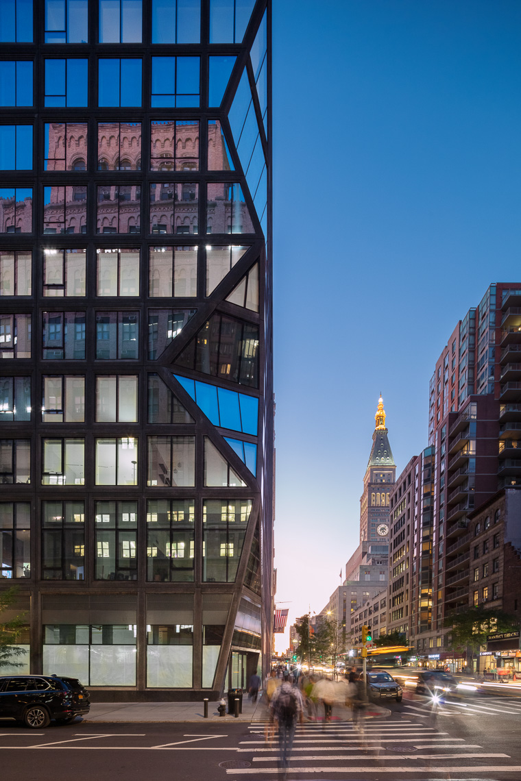 Dynamic glass residential tower and Manhattan streets at dusk