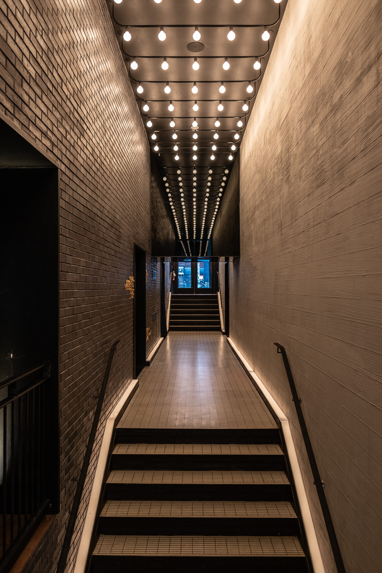 Long stairway entrance with overhead dim lighting