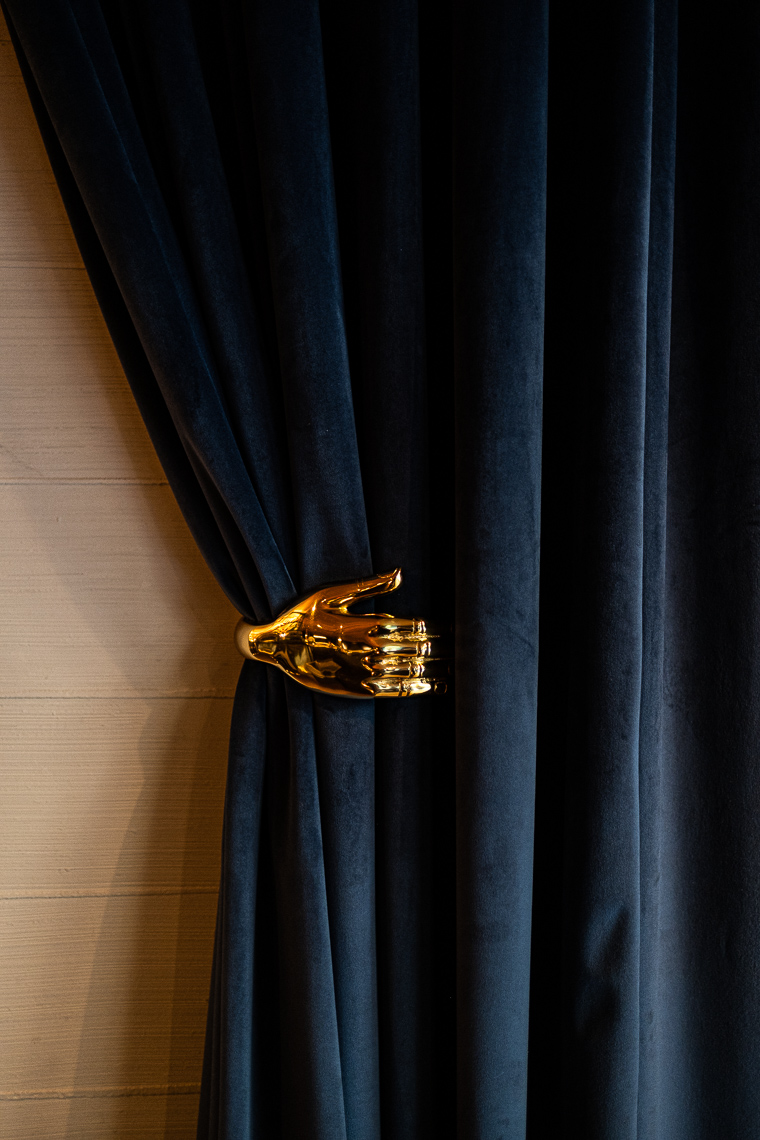 Detail of brass curtain holder
