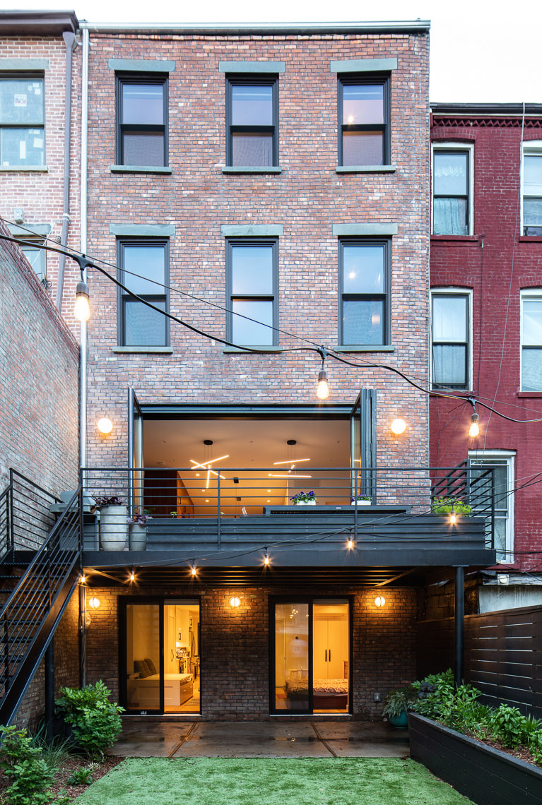 Backyard and elevation of a transformed brownstone in Bedford-Stuyvesant neighborhood of Brooklyn, New York