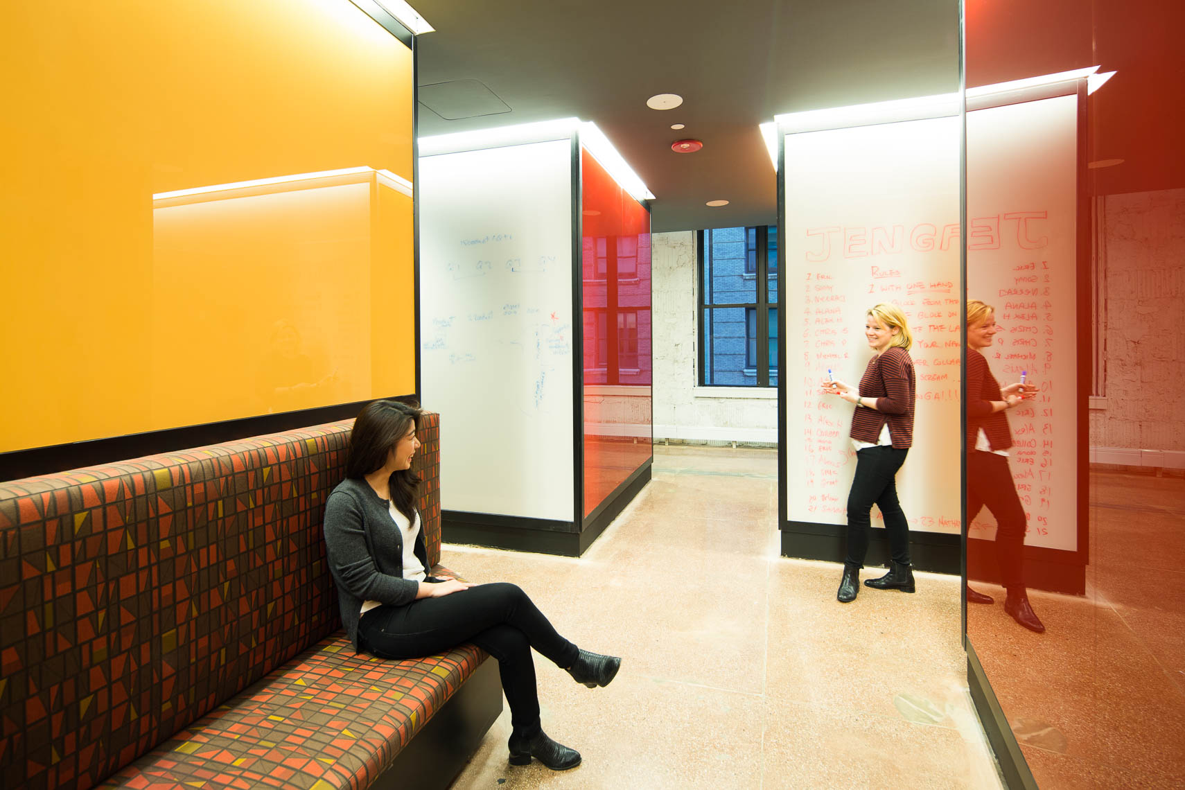 Colorful backlit whiteboards in an open collaboration area