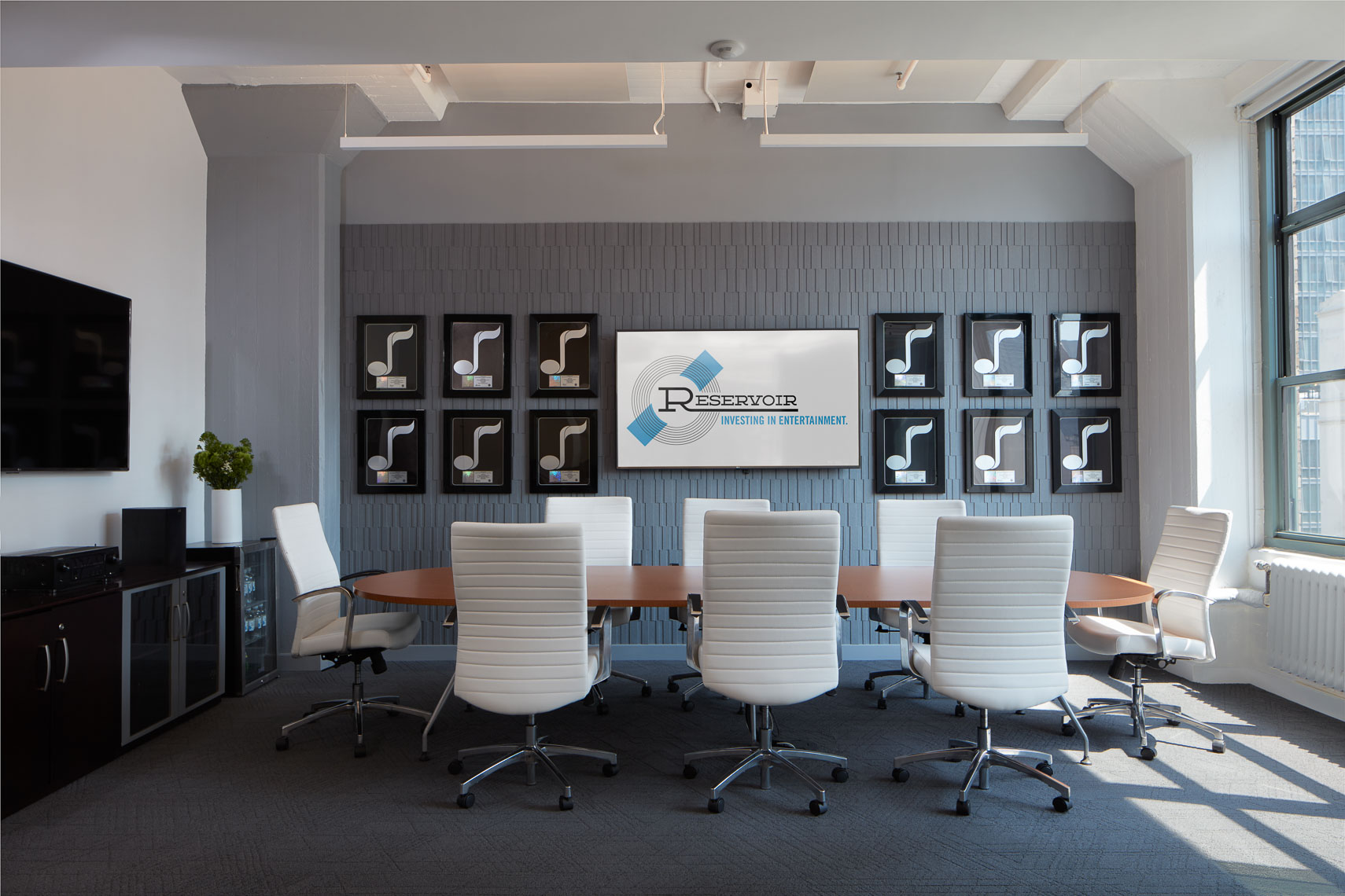 Custom conference room interiors of media offices with plaques on wall