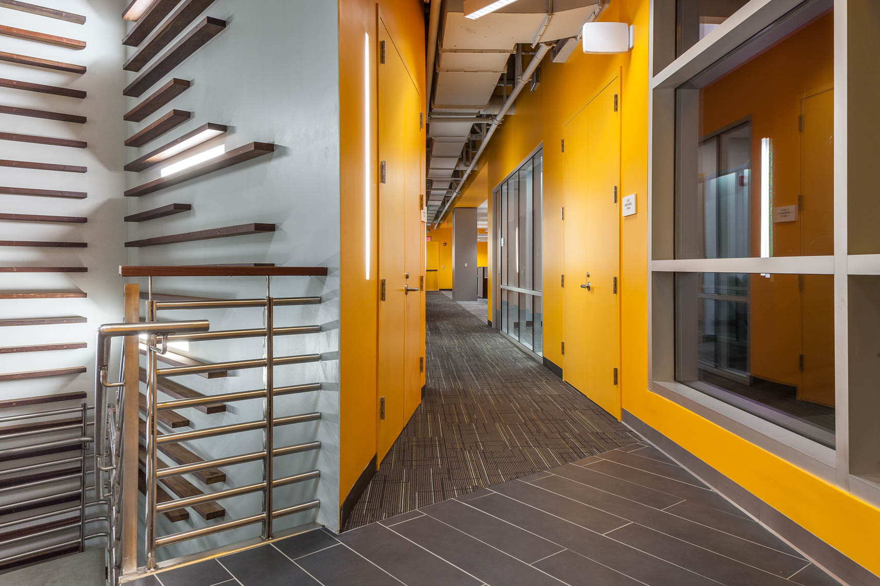 Long corridor with dynamic lighting and yellow walls at night