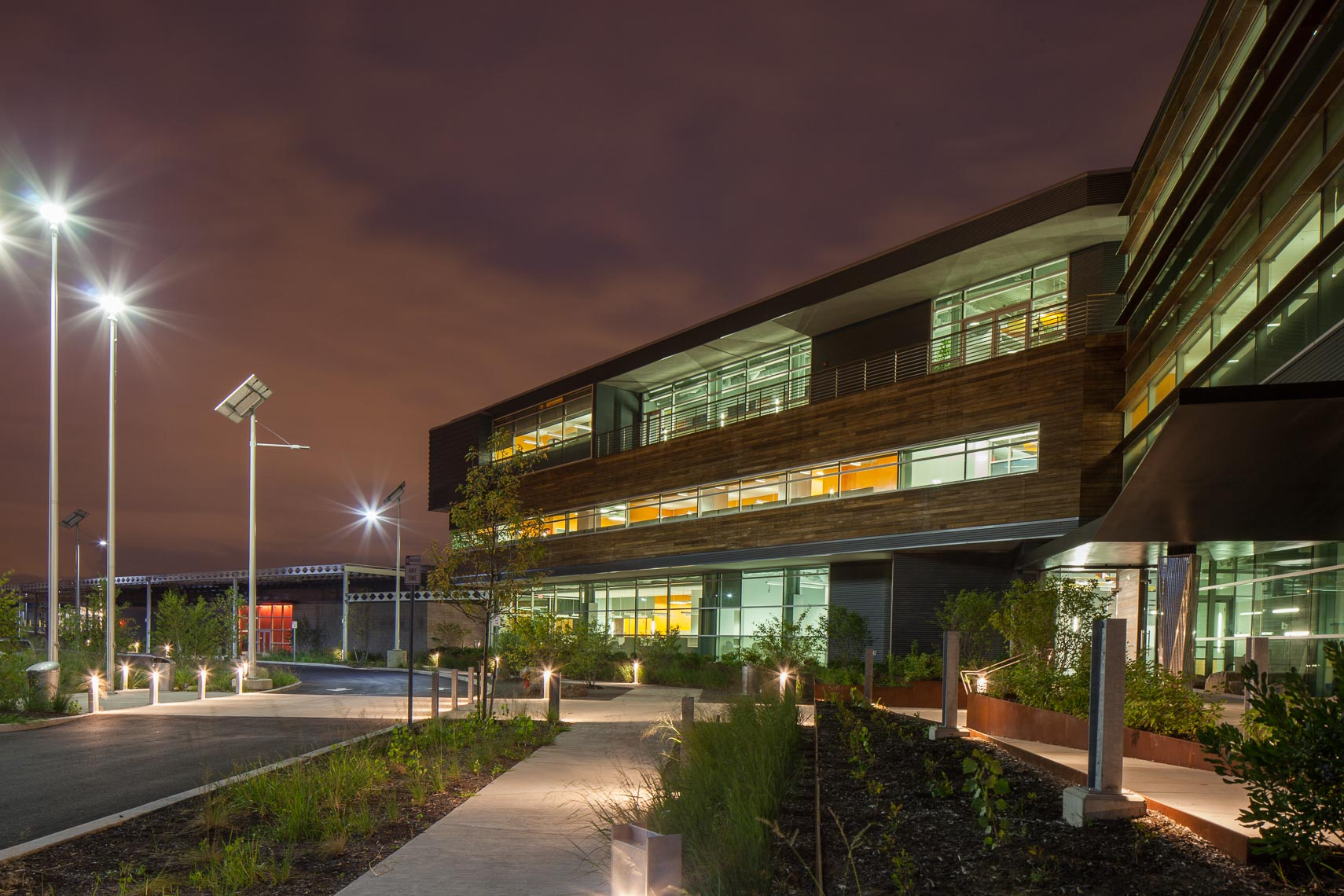 Front elevation of large office building at night