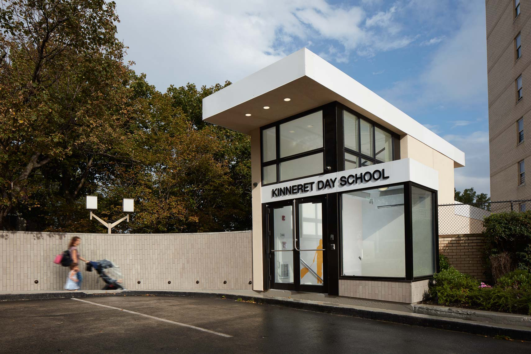 Exterior facade of school with a glass enclosed front entrance