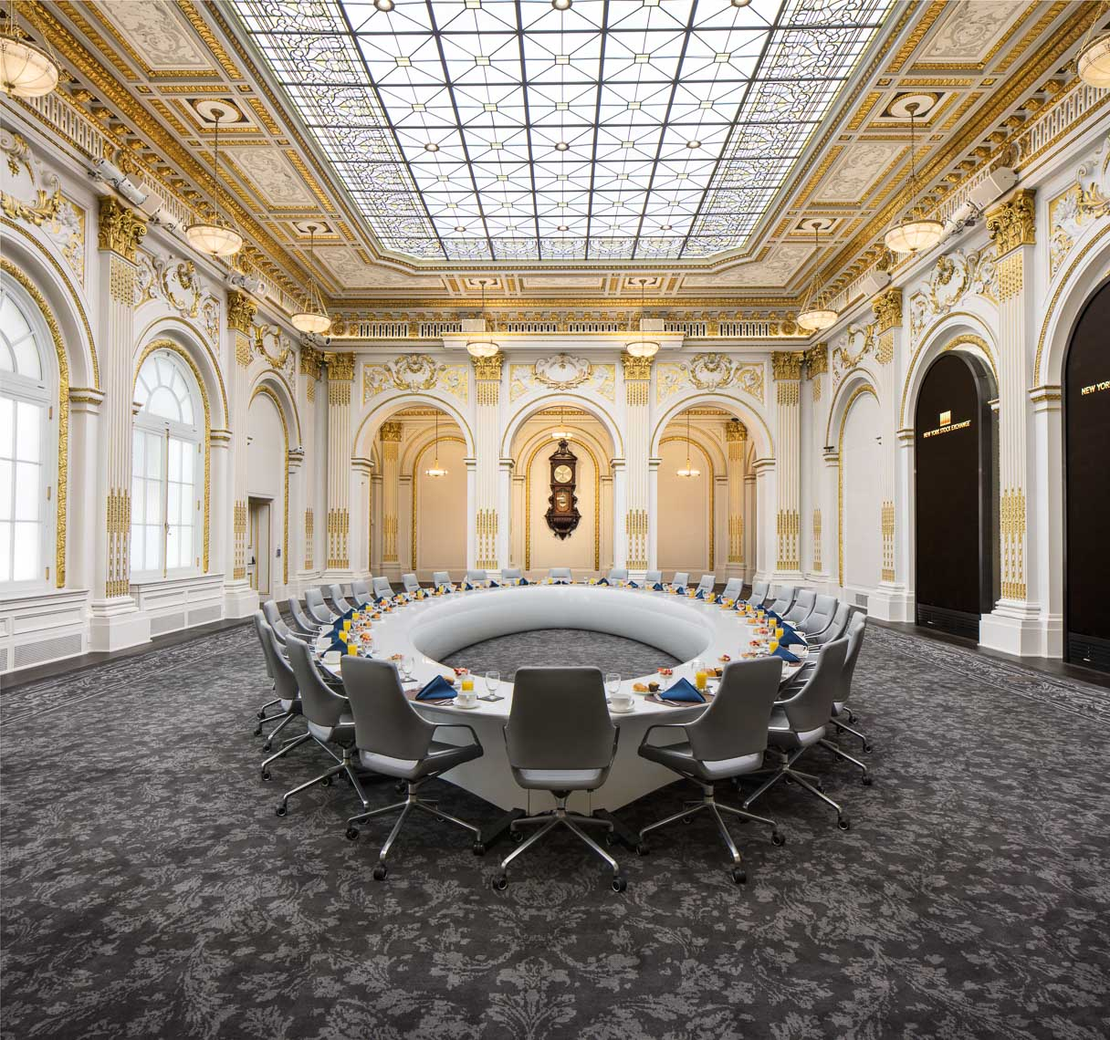 Gilded traditional conference room with large round table and chairs