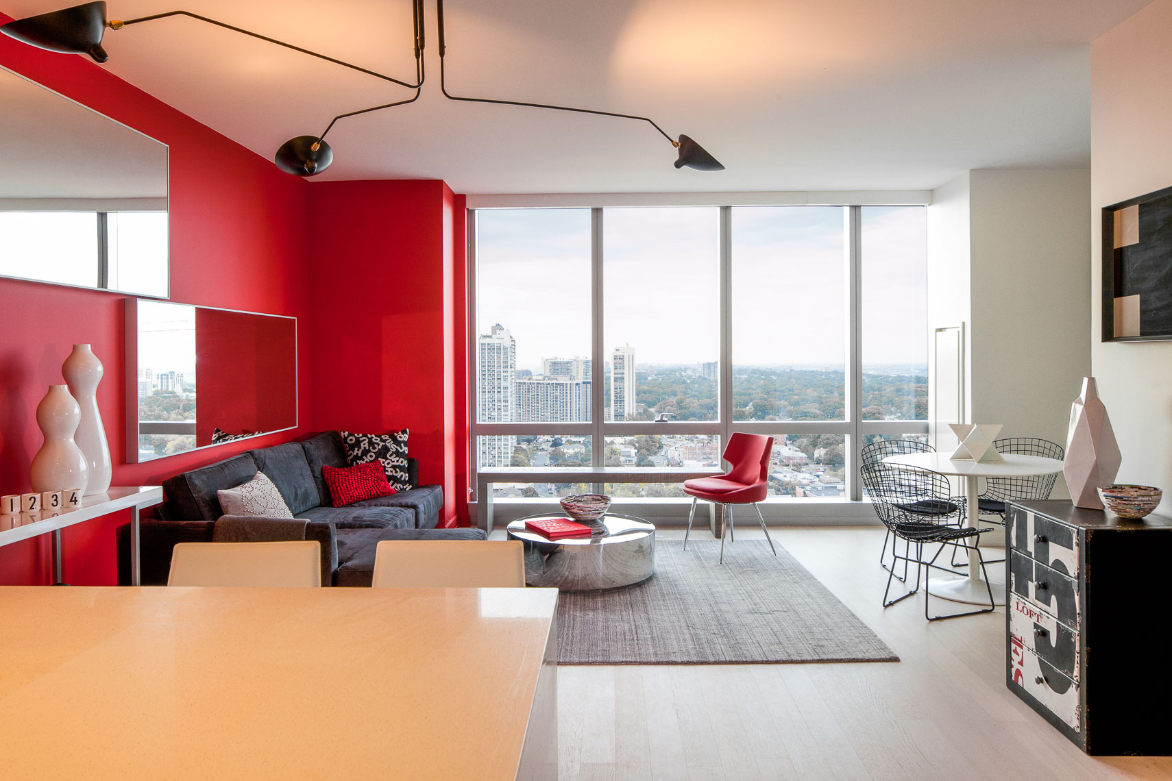 Modern interiors of a luxury apartment with red walls and red chair