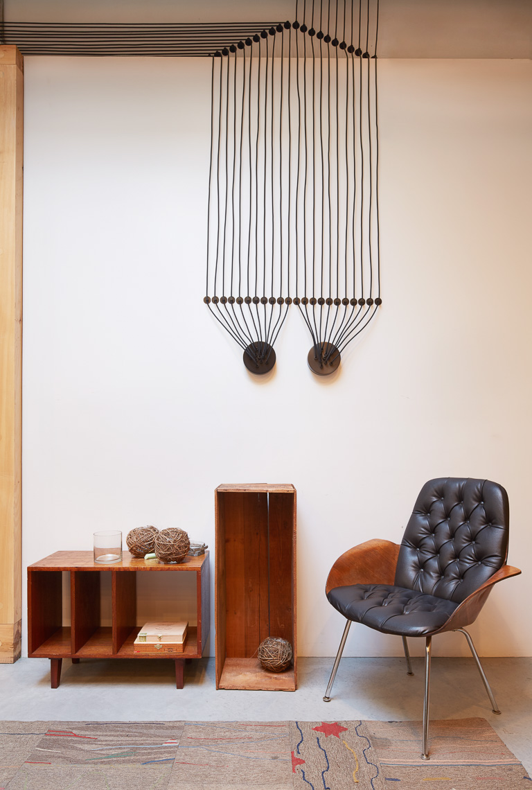 Vignette of midcentury furniture and light fixture