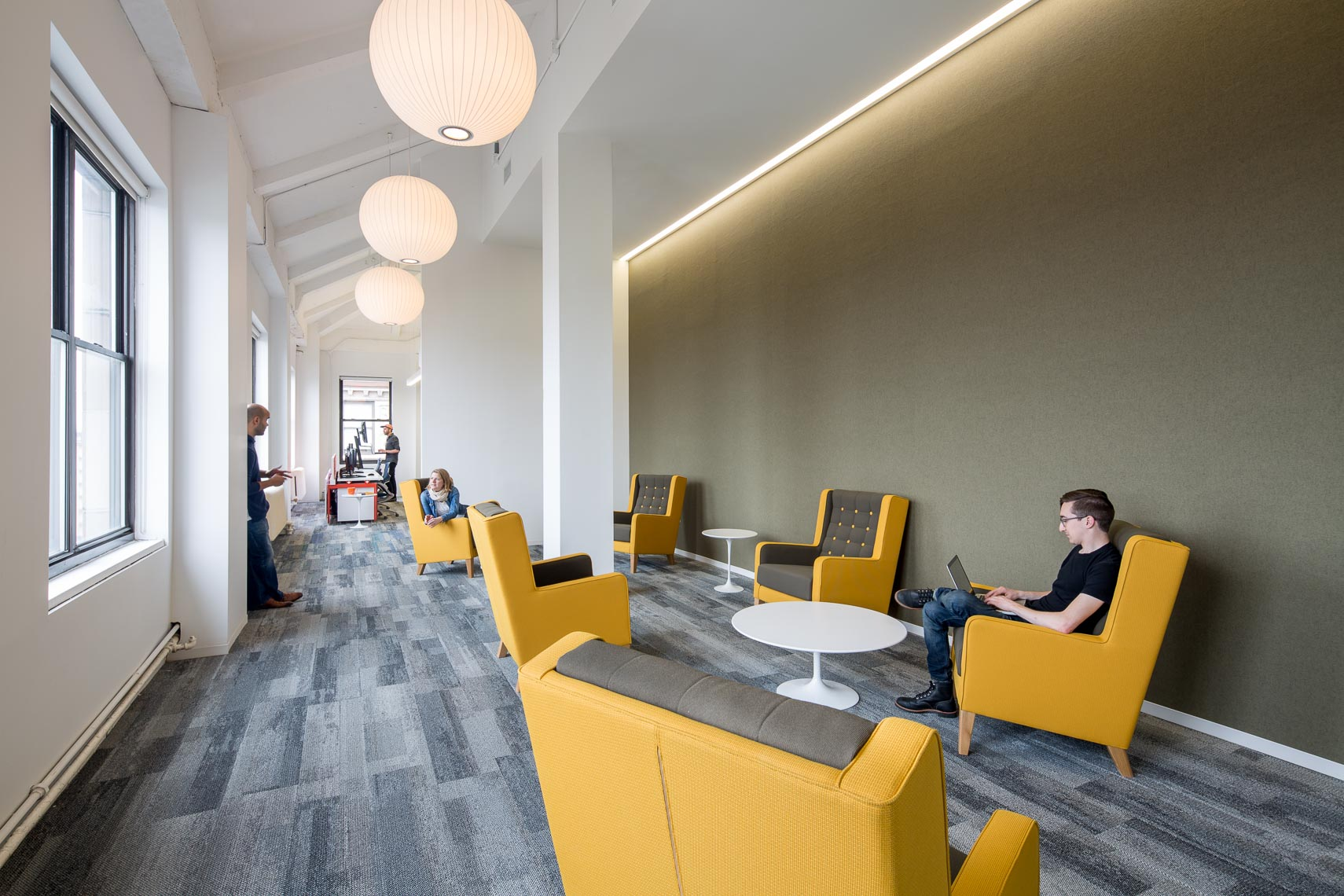 Quiet area with yellow seating in a modern office