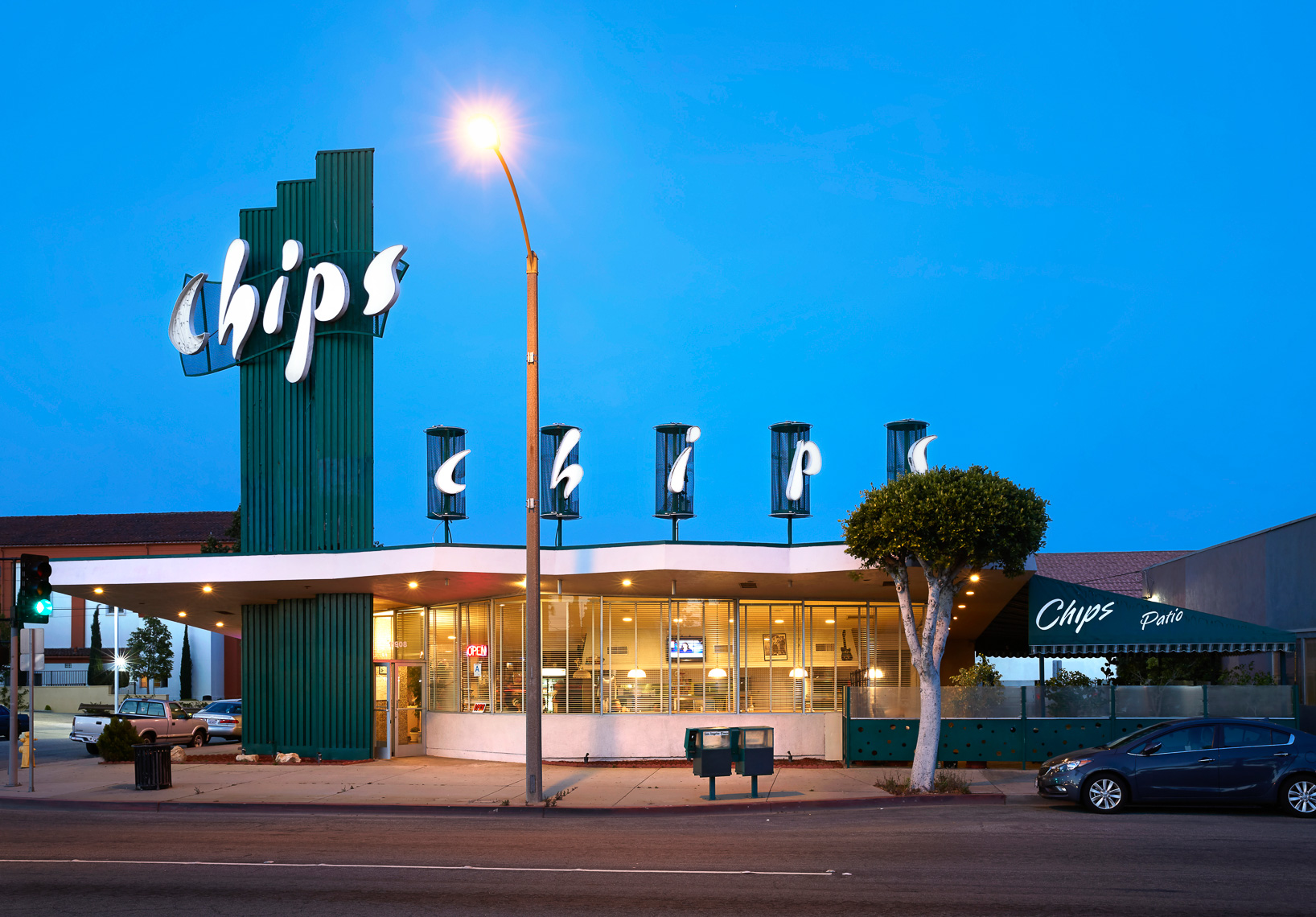 Exterior shot of midcentury diner at dusk